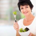 Woman eating salad — Stock Photo