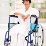 Woman sitting on wheelchair — Stock Photo