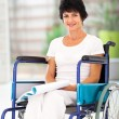 Middle aged woman sitting on wheelchair — Stock Photo