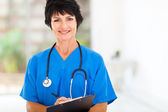 Beautiful female middle aged doctor — Stock Photo