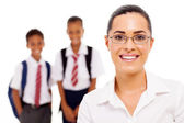 Pretty female elementary school teacher and students — Stok fotoğraf