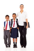 Primary school teacher and students full length portrait on white — Stock Photo