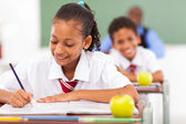 Primary school students in classroom — Stock Photo