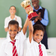 Students holding a trophy — Stock Photo