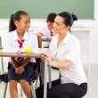 Stock Photo: Schoolgirl and teacher communicating