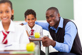 African elementary school teacher and students in classroom — Stock Photo