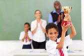 Elementary school student holding a trophy — Stock Photo