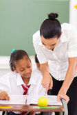 Primary school educator tutoring student — Stock Photo