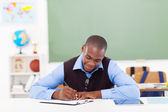 African male teacher preparing a lesson — Stock Photo