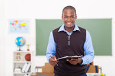 Male teacher holding a clipboard — Stock Photo