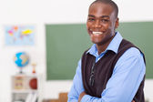Primary male teacher in classroom — Stock Photo