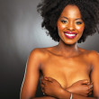 Healthy african american woman covering her breasts — Stock Photo