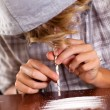 Teenager boy snorting heroin - Stock Photo