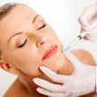 Middle aged woman receiving chin injection — Stock Photo #22389525
