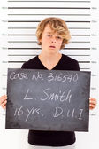 Teen boy get arrested for drunk driving and taking police mug shot — Stock Photo