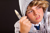Violent teen boy with knife — Stock Photo