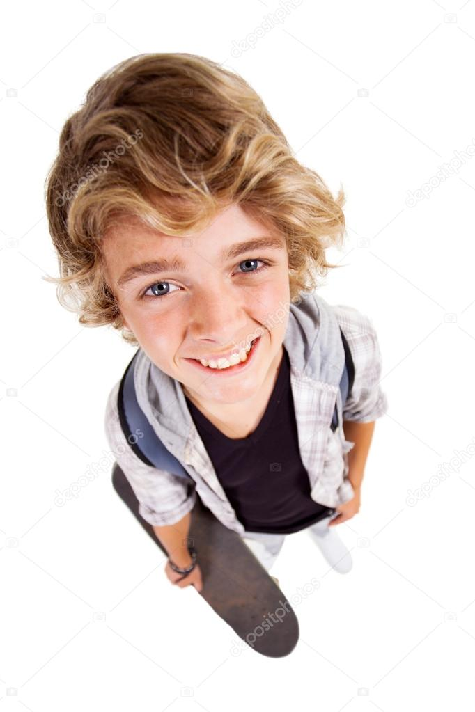 overhead view of cute teen boy on white background stock. Black Bedroom Furniture Sets. Home Design Ideas