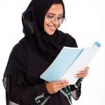 Female Muslim woman reading book — Stock Photo