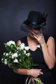 Widow crying at funeral — Stock Photo