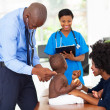 Pediatric doctor examining a child — Stock Photo