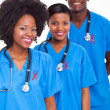 African medical workers with red ribbon — Stock Photo