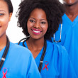 African healthcare workers with red ribbon - Foto Stock