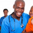 Stock Photo: Pediatric doctor playing with baby boy