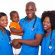 Stock Photo: Group of african pediatricians with baby boy