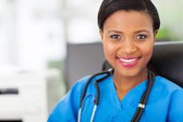 Female african medical nurse with stethoscope — Stock Photo