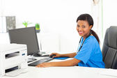 Afro american female doctor sitting in her office — Stock Photo