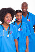 African medical workers with red ribbon — Foto Stock