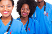 African healthcare workers with red ribbon — Stock Photo