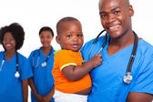 African american male pediatric doctor with little boy — Foto de Stock