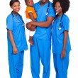 Stock Photo: Group of african doctors with child