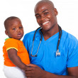afro american male pediatrician with young patient — Stock Photo