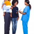 Young female nurse chatting with african family — Stock Photo #23070360