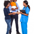 Stock Photo: Africamericfamily with intern nurse