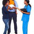 African nurse doing hand shake with patient — Stock Photo