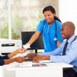 Stock Photo: Caring africnurse handover tissue