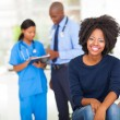 Young african woman waiting for medical examination — Stock Photo
