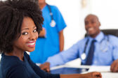 African woman visiting her doctor — Stock Photo