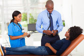 Female african patient lying on doctor's examining couch — Stock Photo