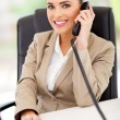 Female switchboard operator answering telephone — Stock Photo