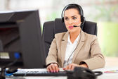 Young female call center operator — Stok fotoğraf