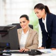 Business women working using computer — Stock Photo