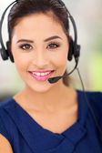 Happy young call centre employee — Stock Photo