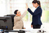 Young business women doing high five — Stok fotoğraf