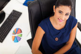 Young office worker sitting in her office — Stock Photo