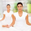 Attractive young women meditating — Stock Photo