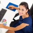 Corporate worker working by her desk — Stock Photo